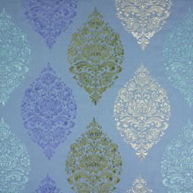 Cressida - Porcelain - Light blue fabric covered with an ornate pattern arranged in pointed diamonds in white, green and other shades of blu