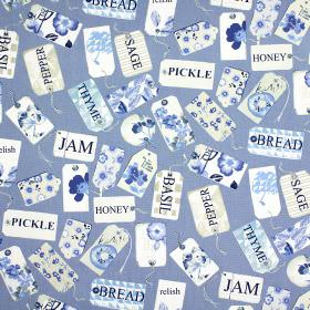 Pantry - Indigo - 100% cotton fabric patterned with tags and the names of storecupboard ingredients in white, grey and shades of blue