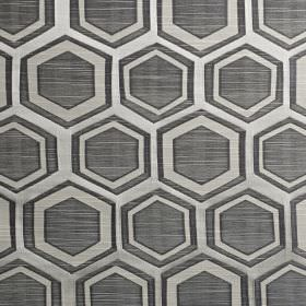 Navoi - Onyx - Dark gunmetal grey coloured polyester and cotton blend fabric printed with pale grey geometric shapes and hexagons