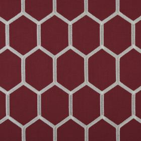 Treillage - Cerise - A honeycomb style hexagon pattern in white against a burgundy polyester and cotton blend fabric background
