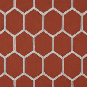 Treillage - Tangerine - Burnt orange coloured polyester and cotton blend fabric behind a white honeycomb style hexagon pattern