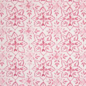 Avignon - Petal - Raspberry coloured small, simple leaves arranged in star shapes printed on white cotton fabric
