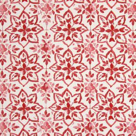 Avignon - Sienna - Dark red coloured star shapes and leaves printed on a background of fabric made from white cotton