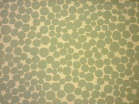 Fizz - Smoke - Circle and pebble shapes printed in a green-grey colour on a background of 100% cotton fabric made in light yellow