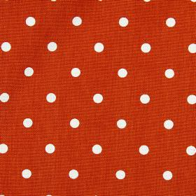 Full Stop - Tile - Fabric made from fiery orange coloured 100% cotton, patterned with a simple white polka dot design