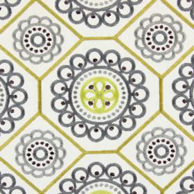 Mambo - Saffron - A series of circles of different sizes in grey and pale yellow embroidered with gold geometric shapes on white fabric