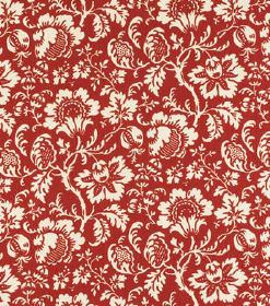 Ellen - Red - Fabric made from red-orange linen, with a repeated pattern of cream coloured flowers and leaves