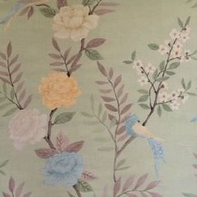 Chinoiserie - Lettuce - Linen fabric in light green, with a pattern of flowers, birds and leaves in green, brown, cream, orange and light bl