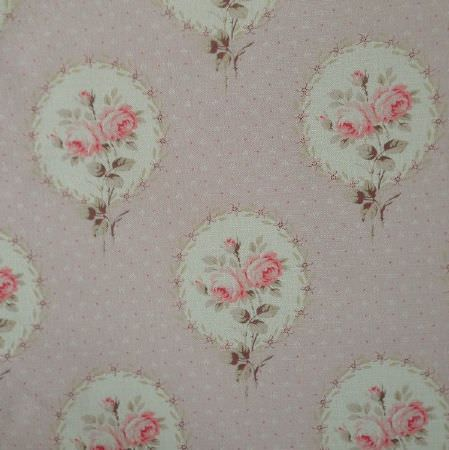 Delfine - Faded Pink - Vintage style pink and green floral designs framed in circles and arranged ondotted light grey oyster linen fabric