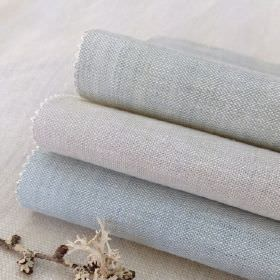 Plain Vintage Linen - Torcello-Seafoam - A flat piece and three rolls of 100% linen fabric in plain, pale shades of blue and grey, with a tw