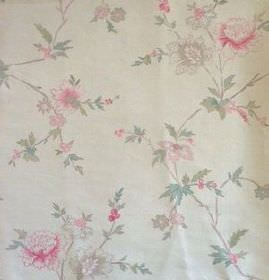 Rupali - Faded Red - Cream coloured 100% linen fabric with a sparse floral pattern of pink flowers and pale green leaves
