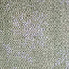 Suzi - Apple - A simple design of small light grey flowers and leaves on a pale green linen fabric background