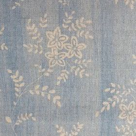 Suzi - Sky - Light blue coloured fabric made from linen, patterned with small, simple flowers and leaves in a light cream colour