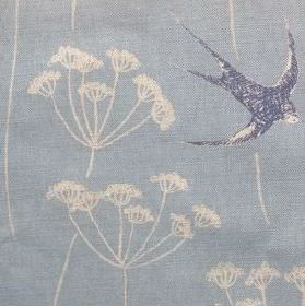 Wiveton - Sky - Dark blue swallows printed with white dandelions on a baby blue natural linen union fabric background