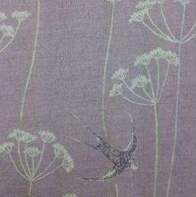 Wiveton - Lavender - Dusky purple natural linen union fabric printed with pale grey dandelions and dark indigo coloured swallows