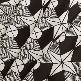 Riad - Riad - Monochrome fabric made from 100% cotton featuring a patterned geometric design of circles and stars in black and white