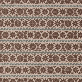Stellar - Charcoal Dawn-Grey - Rows of dark brown flower type designs with dusky blue lines on a warm cream coloured linen fabric background