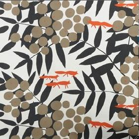 Surt Sa Raven - Brown - Small orange stylised foxes printed with brown circles on a pattern of black leaves, on a white cotton fabric backgr