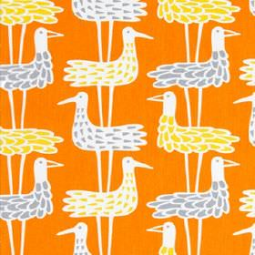 Shorebird - Orange - White stylised birds with light blue & yellow feathers on a background of bright orange fabric made entirely from cotto