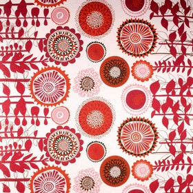 Solros - Red - Linen fabric with a stylised floral print mainly in red and white, featuring circles between horizontal stems and leaves