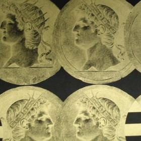 Coins - Gold - Coin style Emperors' faces printed within overlapping grey-cream coloured circles on black 100% cotton fabric
