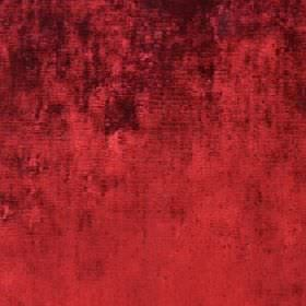 Diva - Red Rose - Some very dark red-brown patches covering a cotton, viscose and polyester blend fabric in a bright, fiery shade of red