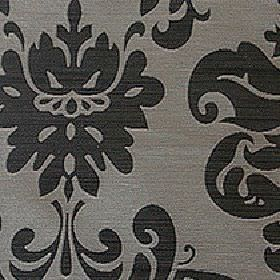 Sojana - Caviar - 100% Trevira CS fabric in concrete grey and black, printed with a large, simple, stylised floral and swirl pattern