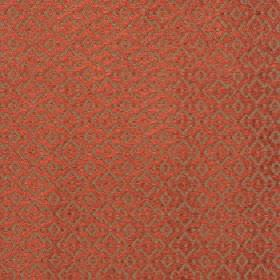 Isamal - Rust - Jagged diamond shapes arranged repeatedly over rust and brown coloured cotton, viscose and polyester blend fabric