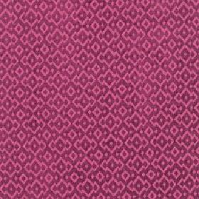 Isamal - Beaujolais - Hot pink and dark purple coloured jagged diamond shapes arranged repeatedly on cotton, viscose and polyester fabric