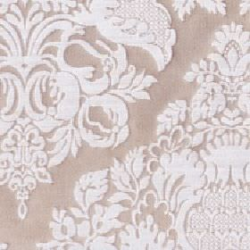 Cecile - Sandshell - Light brown cotton and polyester blend fabric behind a large pattern, floral and leaf design in a plain white colour