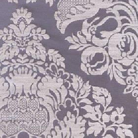 Cecile - Coudburst - Large ornate silver coloured patterns, flowers and leaves on a dark grey-blue cotton and polyester blend fabric backgroun