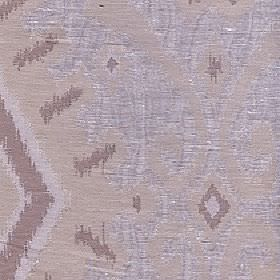 Marcia - Ivory - Fabric made from polyester and linen with a tribal style geometric and swirl design in light shades of beige, grey and brown