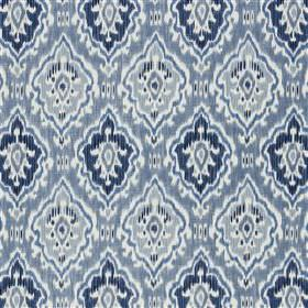 Saphia - Ocean - White and several shades of blue making up a design of rows of patterned diamonds on viscose and linen blend fabric