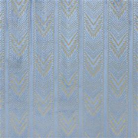 Tippolo - Ocean - Light shades of blue and grey making up a viscose, linen & polyester blend fabric with a chevron patterned stripe design