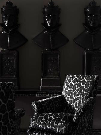Andrew Martin -  Anthem Fabric Collection - Two white upholstered armchairs decorated with a pattern of dark grey leopard dots with black borders