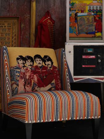 Andrew Martin -  Beatles Fabric Collection - Occasional chair with bold blue, orange and white stripes with The Beatles depicted on an orange background.