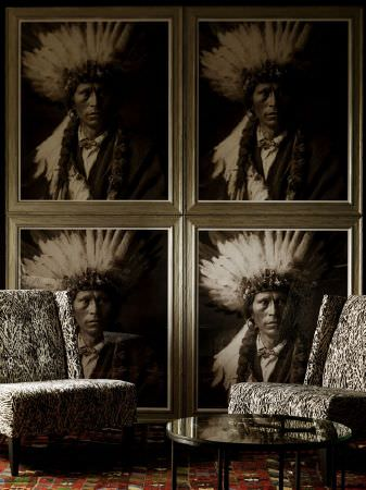 Andrew Martin -  Clarendon Fabric Collection - Four large Native American paintings in silver frames, with two low, padded black and white ornately patterned chairs