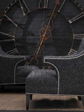 Andrew Martin -  Lombard Fabric Collection - Contemporary chairs coverd in dark blue/black fabric with swiirls.