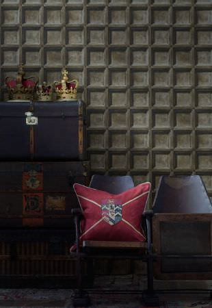 Andrew Martin -  Lost and Found Fabric Collection - Three dark blue chests, with a row of flip-up navy blue and wooden seats, with one dark burgundy crest print cushion
