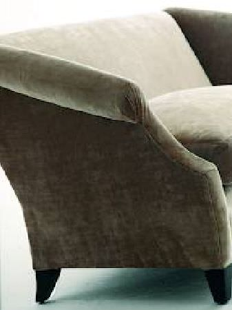 Andrew Martin -  Motcomb Fabric Collection - Sofa in plain, pale grey-green velvet-like fabric.