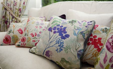 Art of the Loom -  Art of the Loom Fabric Collection - A collection of cushions with white front featuring a floral pattern and the back in one single colour