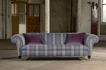 Art of the Loom -  Art of the Loom Fabric Collection - Modern couch featuring a pattern of wide blue and purple stripes with thin stripes inside of them