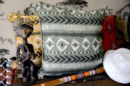 Art of the Loom -  Art of the Loom Fabric Collection - Cushions in light blue, yellow and red decorated with interesting tribal patterns in white and grey