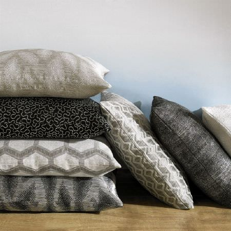 Ashley Wilde -  Axel Fabric Collection - Seven square scatter cushions, each featuring a different pattern, all in black, grey, cream and silver shades