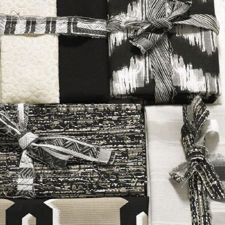 Ashley Wilde -  Blake Fabric Collection - Boxes wrapped in different black, white, grey and cream patterned fabrics, some tied with black and grey fabric bows