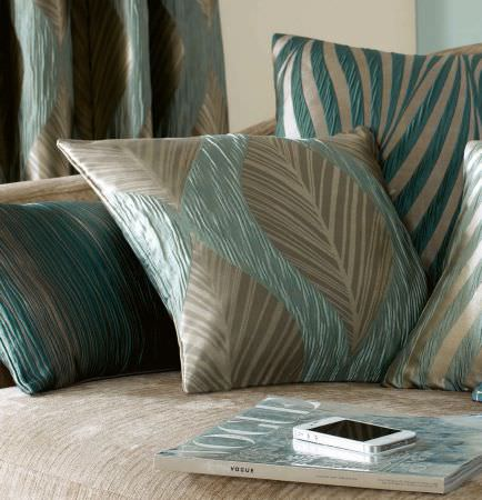 Ashley Wilde -  Botinia Fabric Collection - Collection featuring a set of gold cushions featuring turquoise decorations and a matching curtain