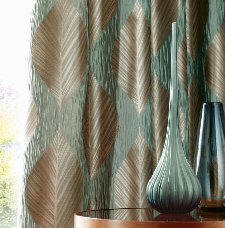 Ashley Wilde -  Botinia Fabric Collection - Elegant curtain dyed in colour gold decorated with a pattern of shiny, wavy stripes in colour turquoise