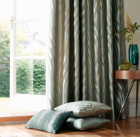 Ashley Wilde -  Botinia Fabric Collection - Elegant curtain in colour gold featuring turquoise decorative pattern and a matching design on cushions