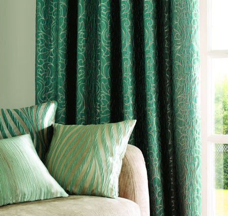 Ashley Wilde -  Botinia Fabric Collection - Silky green curtain decorated with elegant pattern in gold and a collection of gold cushions with mint green decorations