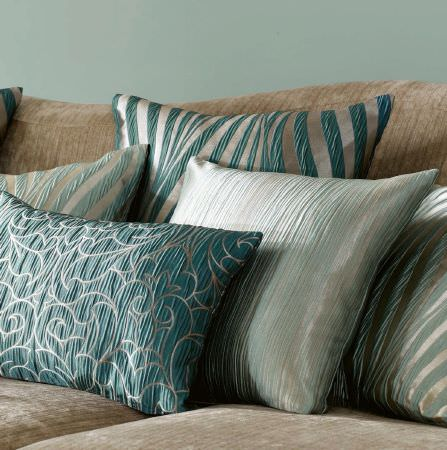 Ashley Wilde -  Botinia Fabric Collection - Elegant silky cushions dyed in colour gold featuring different decorative patterns in turquoise